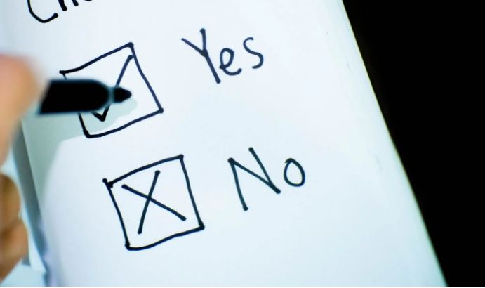 Hand drawn yes and no check boxes with pen ticking yes and no already crossed